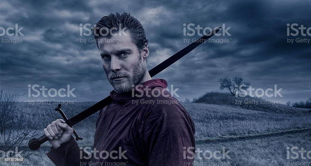Portrait of Viking warrior holding a sword stock photo