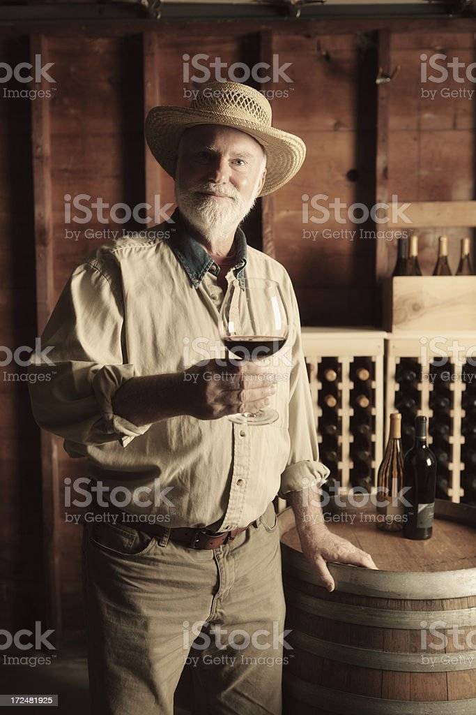 Portrait of Vintner Winemaker in the Cellar Vertical royalty-free stock photo