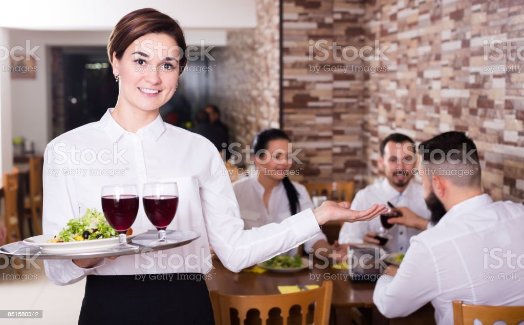 Portrait of waitress working in ordinary restaurant stock photo