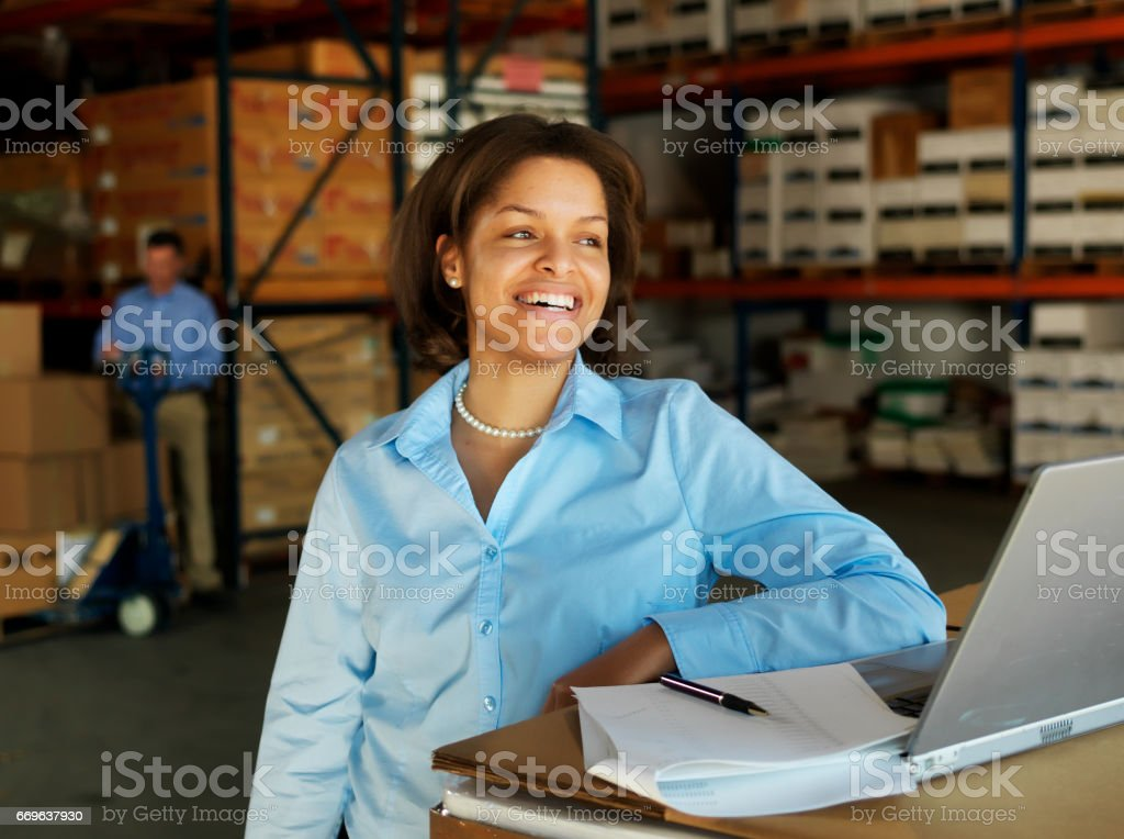 Portrait of Warehouse Businessman with Laptop stock photo
