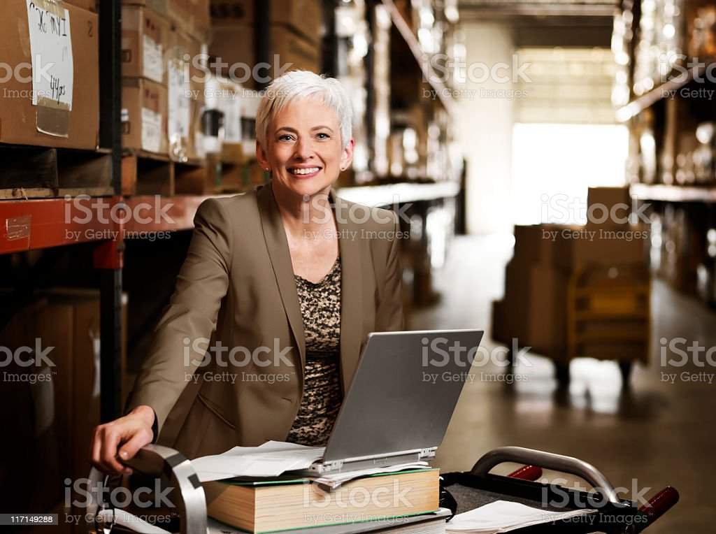 Portrait of Warehouse Businesswoman with Laptop royalty-free stock photo