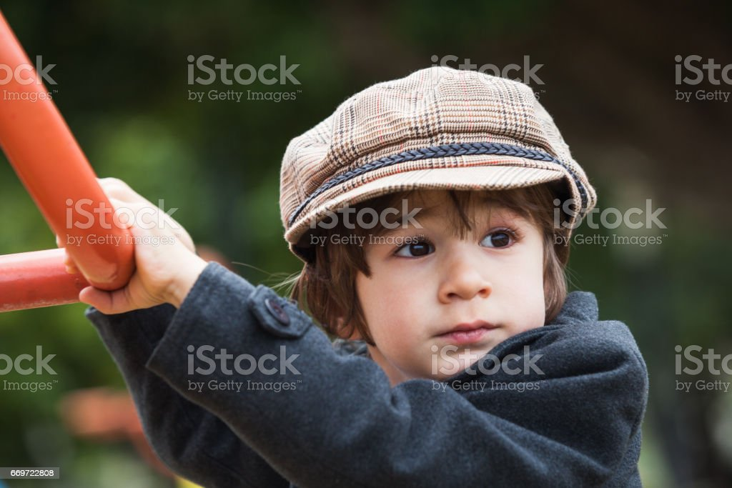 Portrait Of Well Dressed Little Boy In Outdoor. stock photo