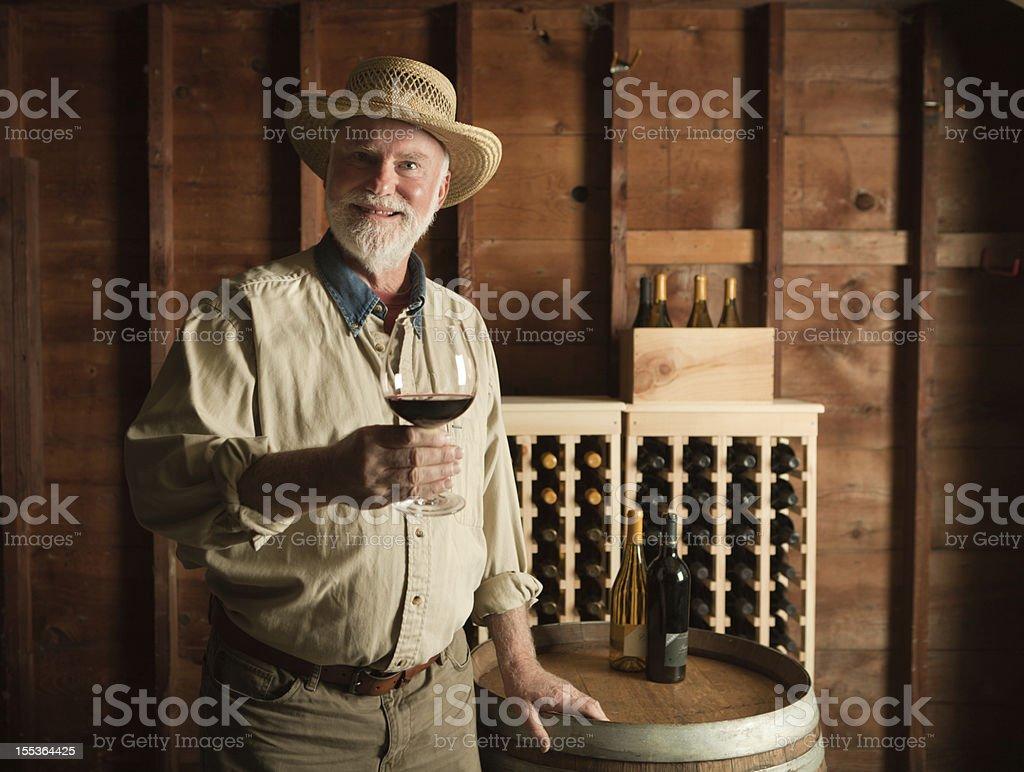 Portrait of WineMaker Vintner Tasting in the Cellar Hz royalty-free stock photo