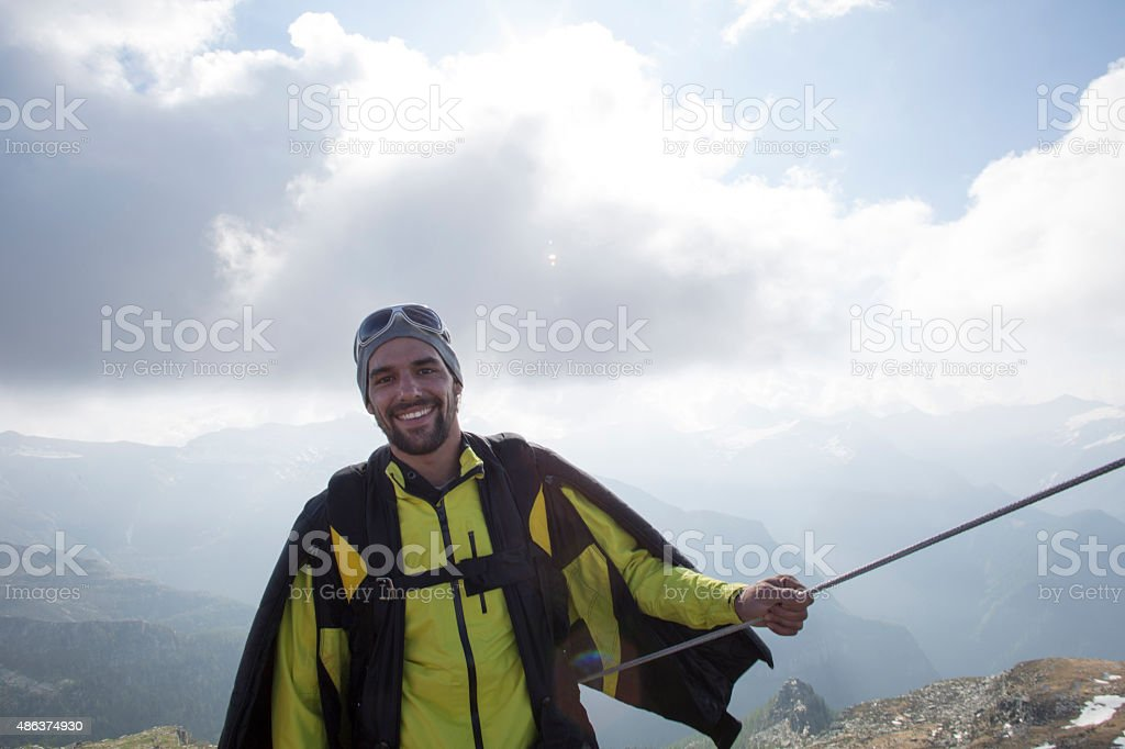 Portrait of wingsuit jumper about to launch stock photo