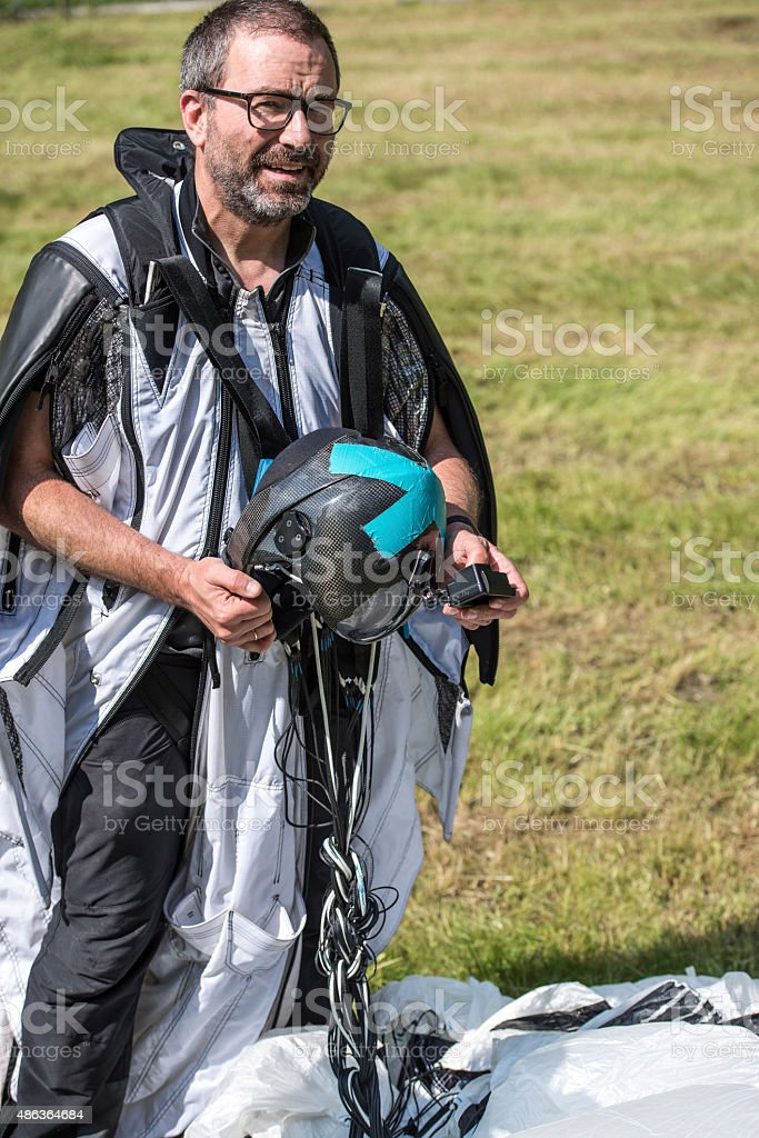 Portrait of wingsuit jumper in mountain meadow stock photo