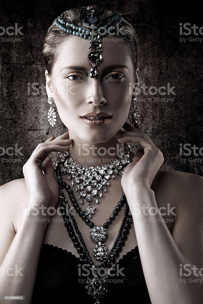 portrait of woman advertising luxury jewellery stock photo