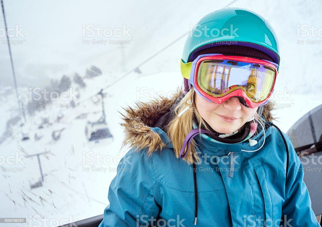 Portrait of woman at ski resort stock photo