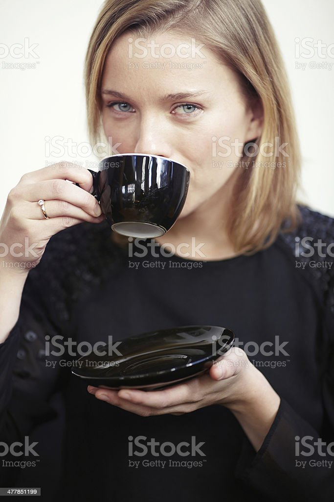 Portrait of woman drinking from coffee cup royalty-free stock photo