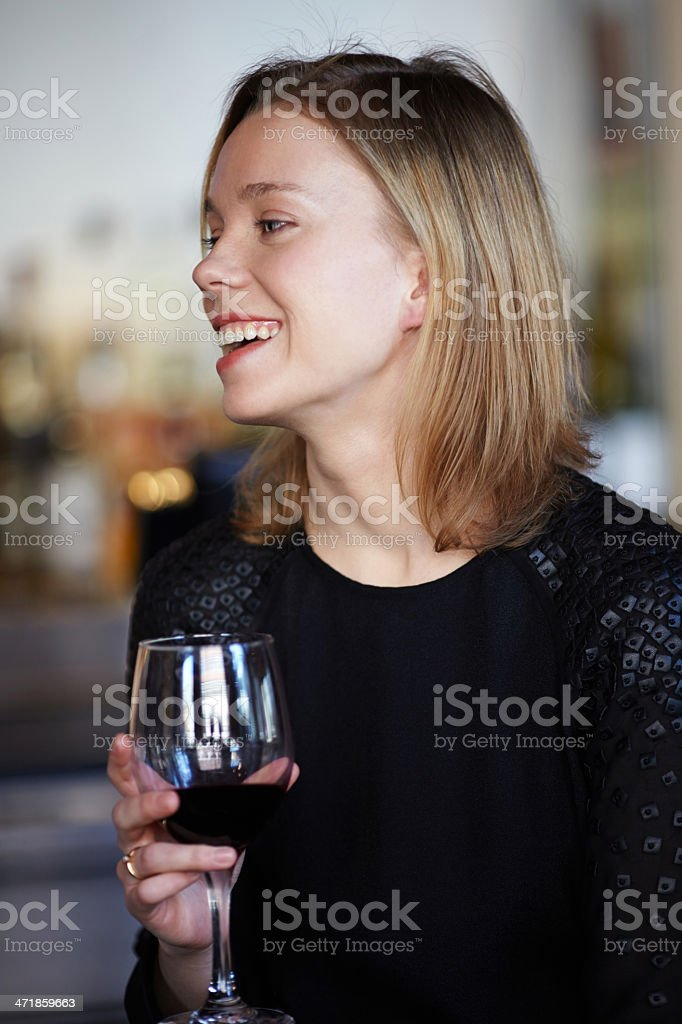 Portrait of woman drinking from red wineglass smiling royalty-free stock photo
