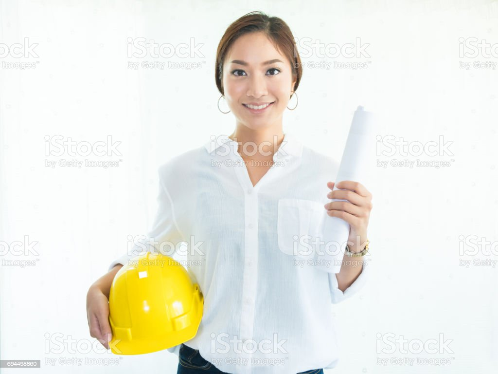 A portrait of woman engineer working in office stock photo