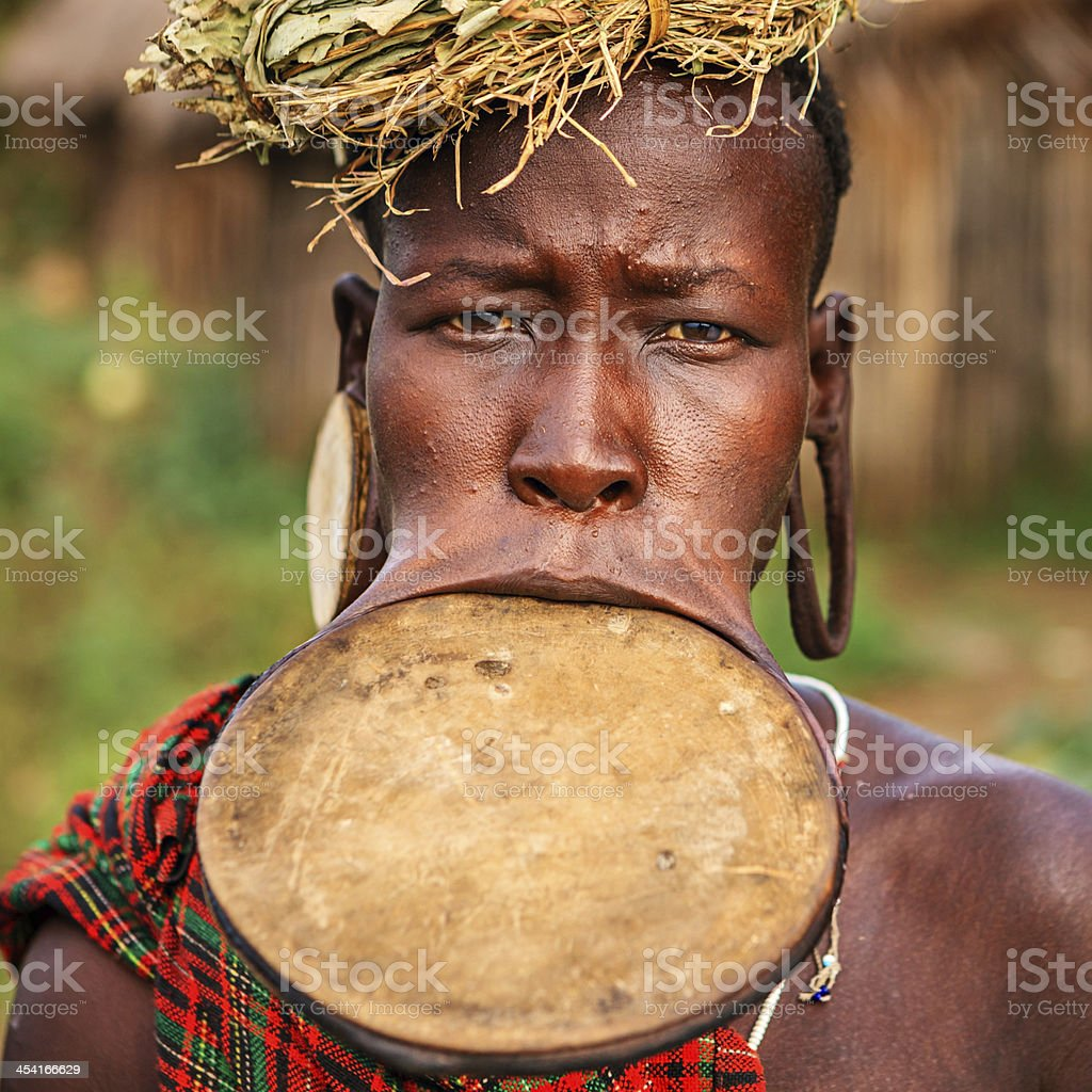 Portrait of woman from Mursi tribe, Ethiopia, Africa royalty-free stock photo