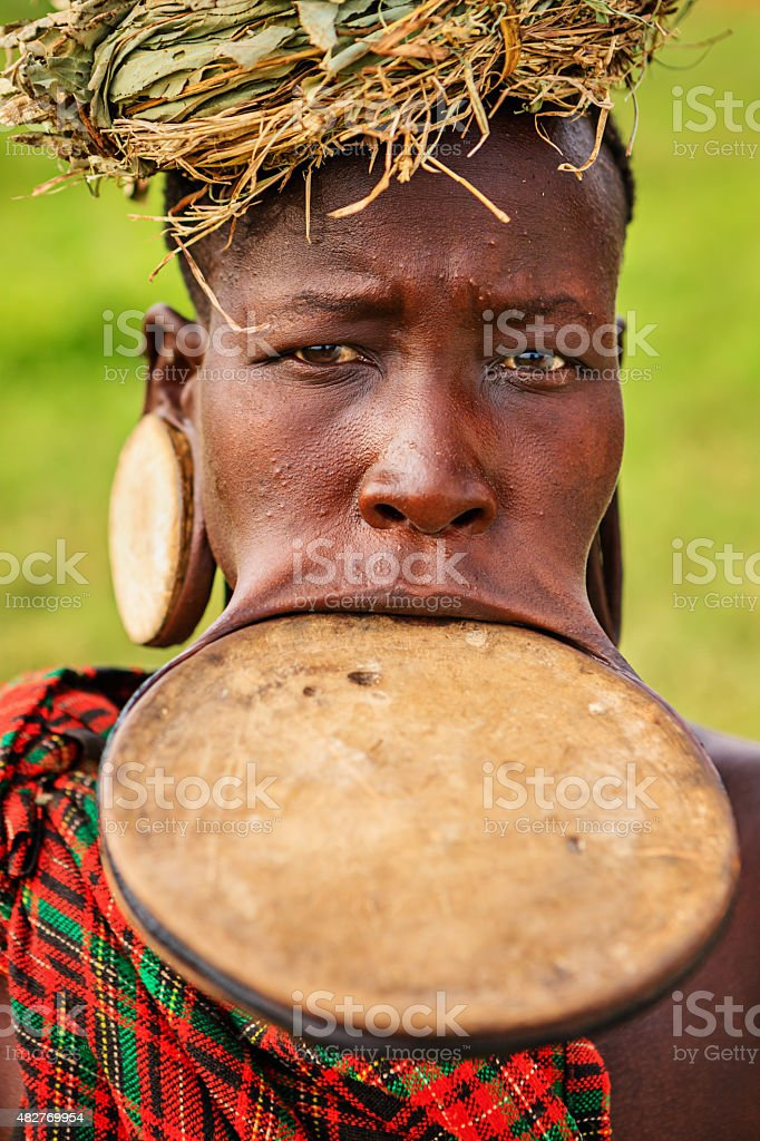 Portrait of woman from Mursi tribe, Ethiopia, Africa stock photo
