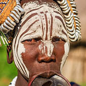 Portrait of woman from Mursi tribe, Ethiopia, Africa