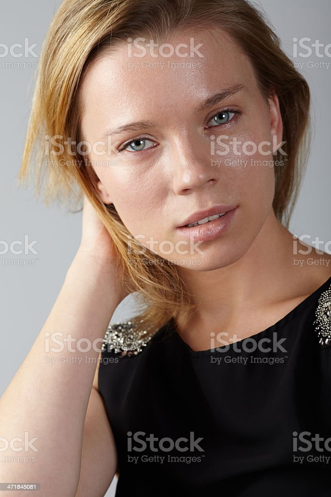 Portrait of woman hand behind head royalty-free stock photo