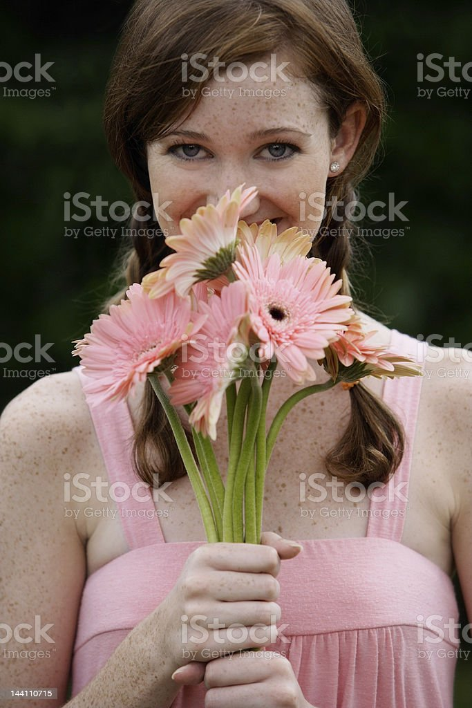 Portrait of woman holding bouquet of flowers royalty-free stock photo