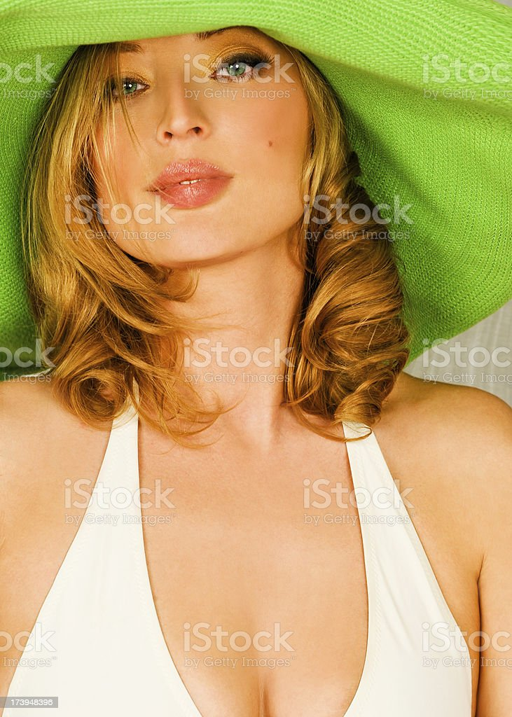 Portrait of woman in a green hat. stock photo