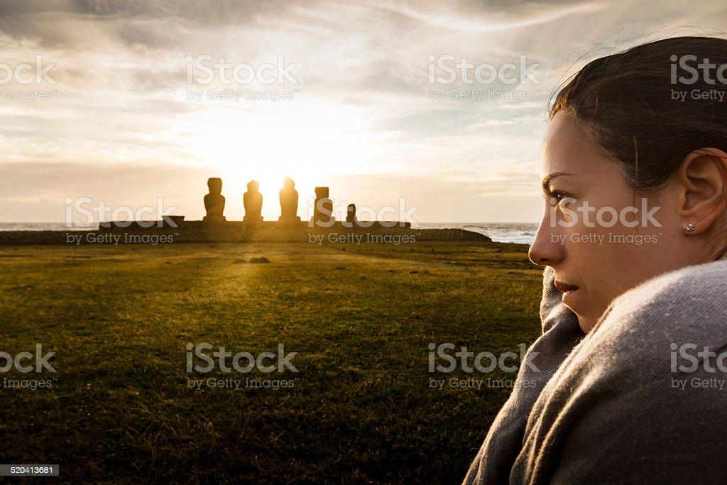 Portrait of Woman in Ahu Tahai Moai Statues at Sunset stock photo