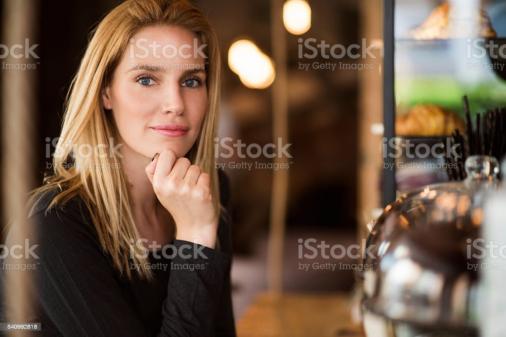 Portrait of woman in coffee shop stock photo