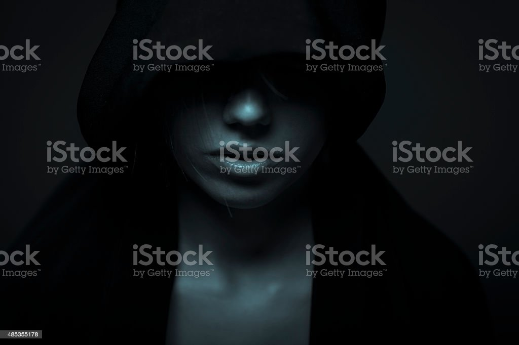 Portrait Of Woman In Darkness stock photo