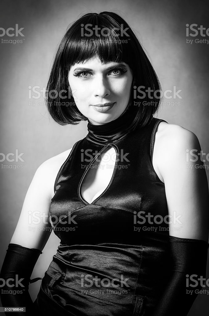 Portrait of woman in evening dress and long gloves stock photo