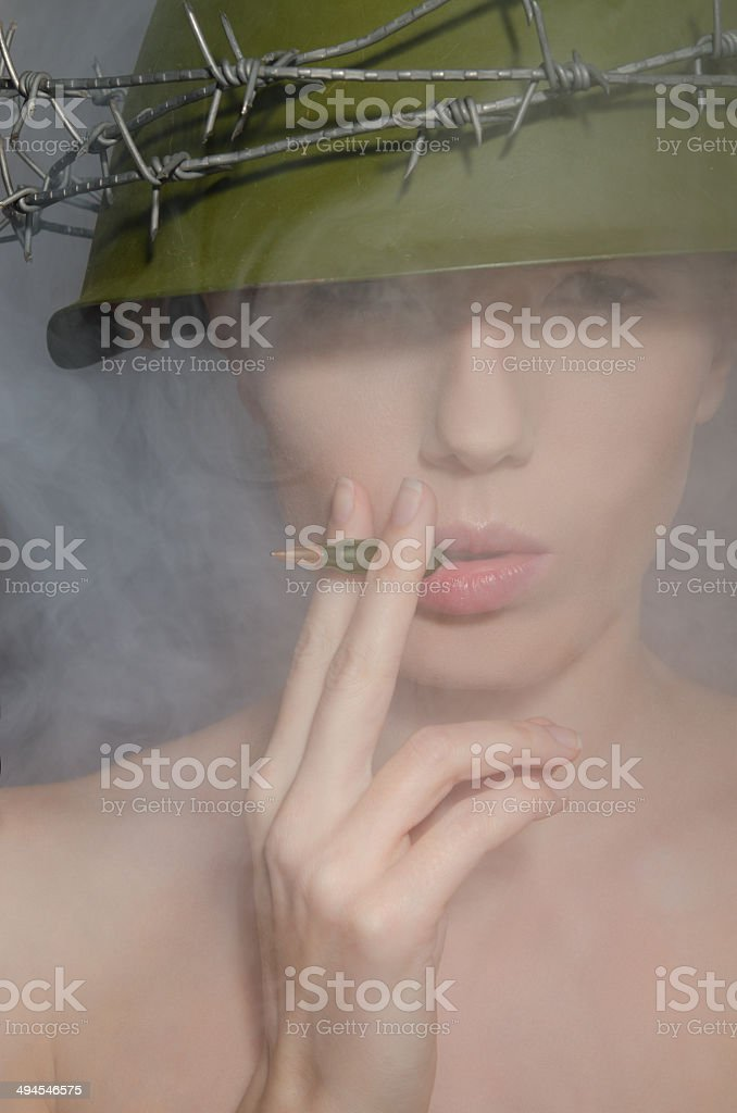 Portrait of woman in fog with a helmet stock photo