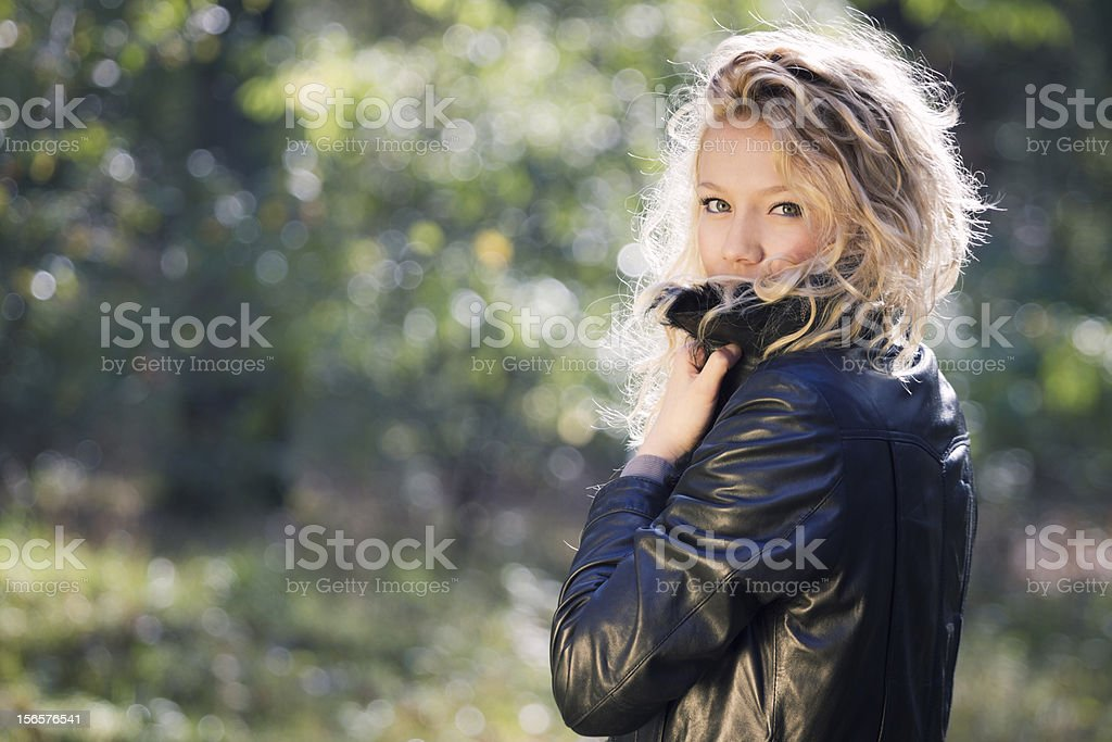 Portrait of woman in forest stock photo