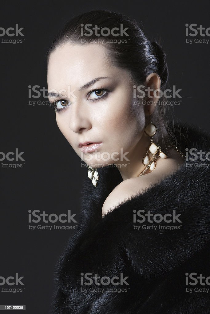 portrait of woman in fur coat royalty-free stock photo