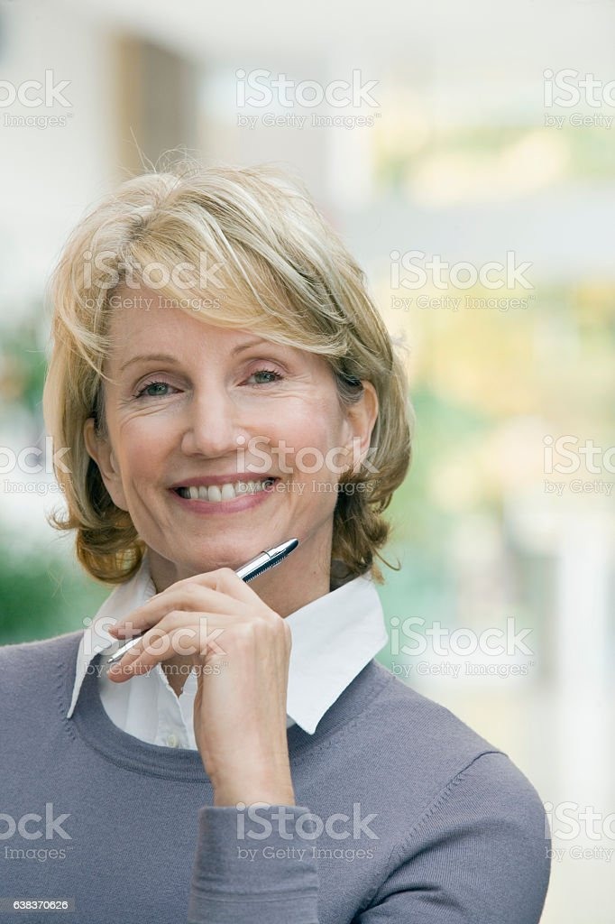 Portrait of woman in office lobby stock photo