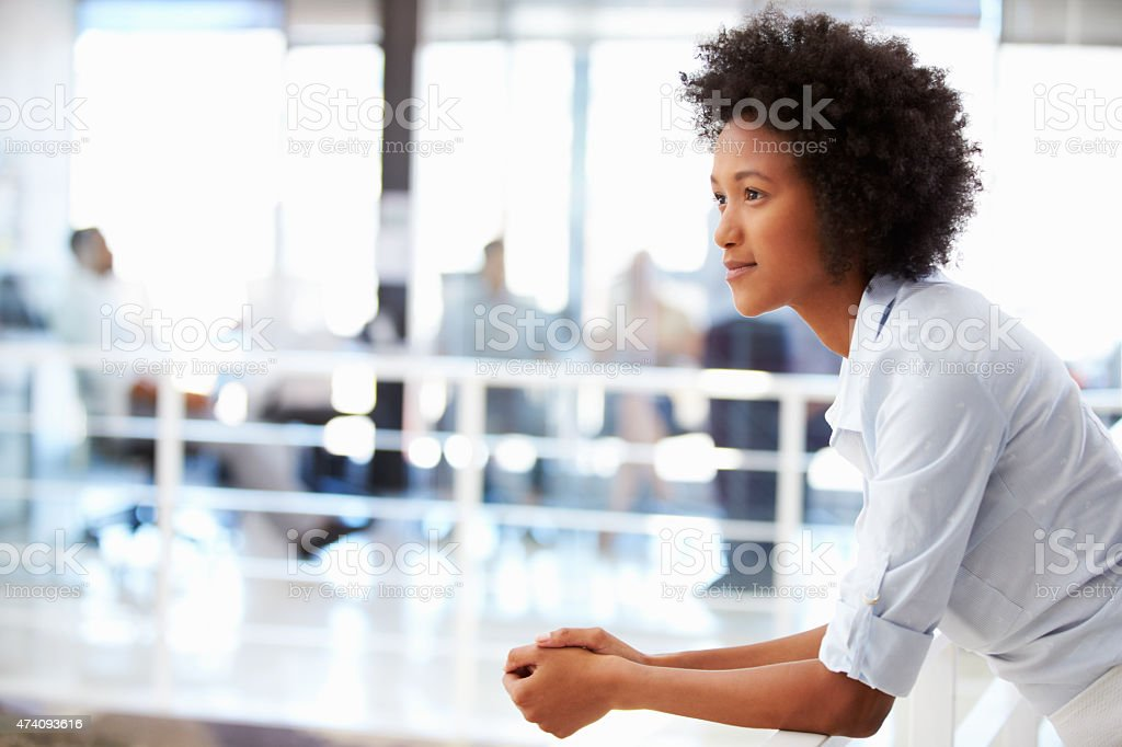 Portrait of woman in office, side view stock photo