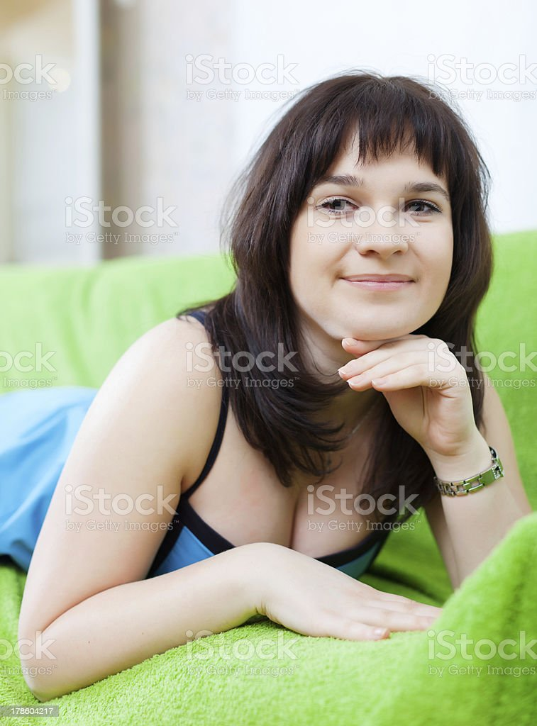 Portrait of  woman lying on couch royalty-free stock photo