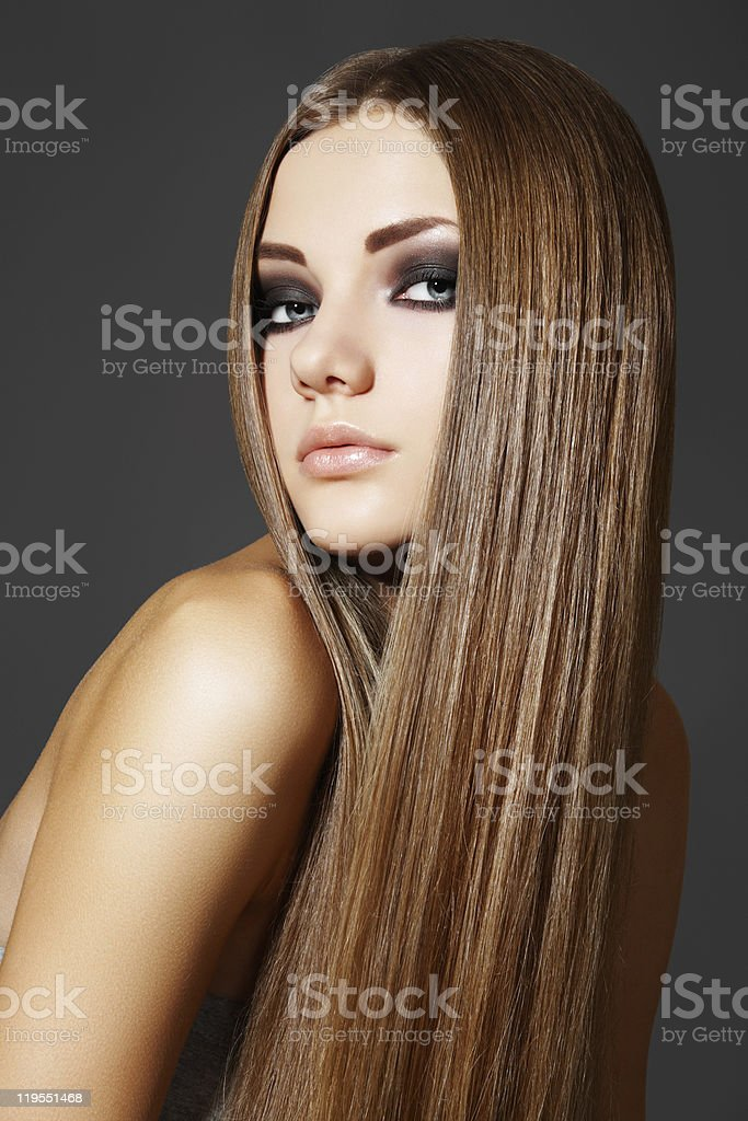 Portrait of woman model with shiny long brown hair stock photo