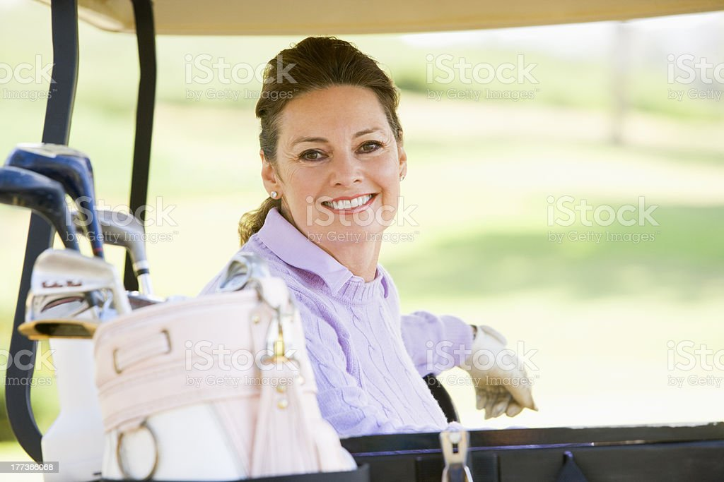 Portrait Of Woman Sitting In A Golf Cart royalty-free stock photo