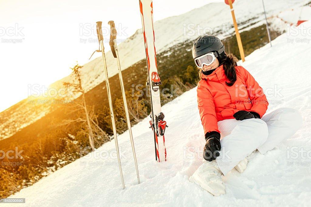 Portrait of woman sitting on snow, enjoying the view stock photo