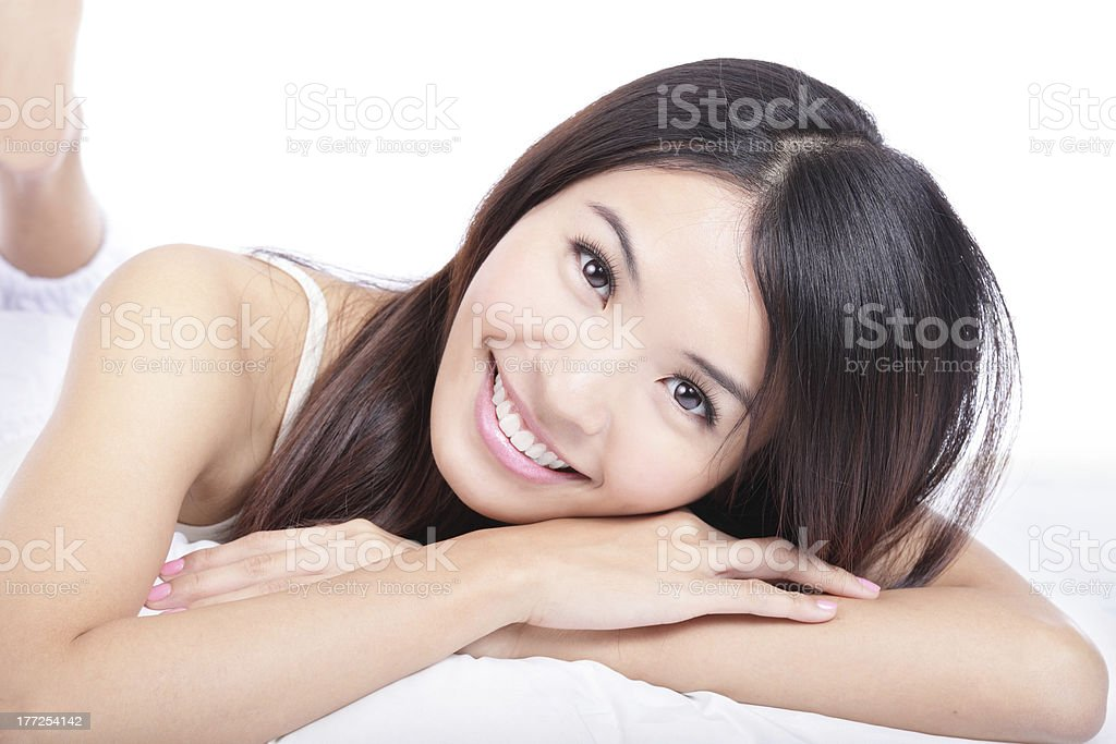portrait of woman smile face lying on bed royalty-free stock photo