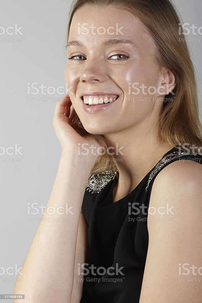 Portrait of woman smiling hand on chin royalty-free stock photo