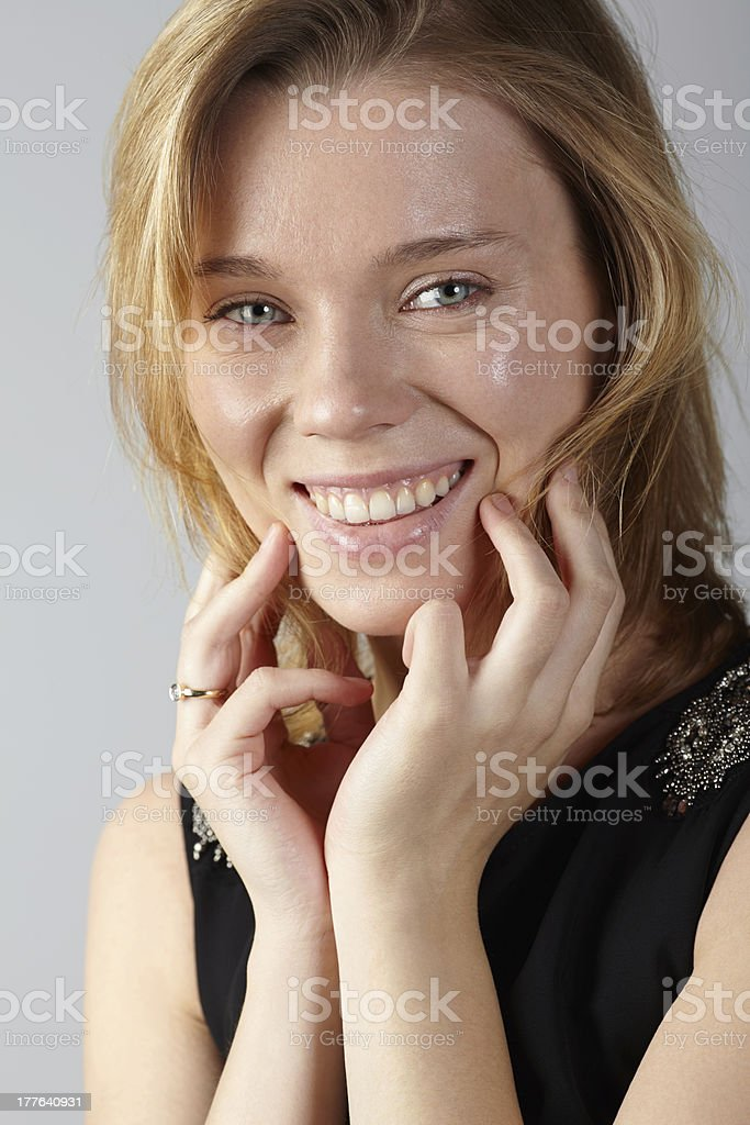Portrait of woman smiling hands on chin royalty-free stock photo