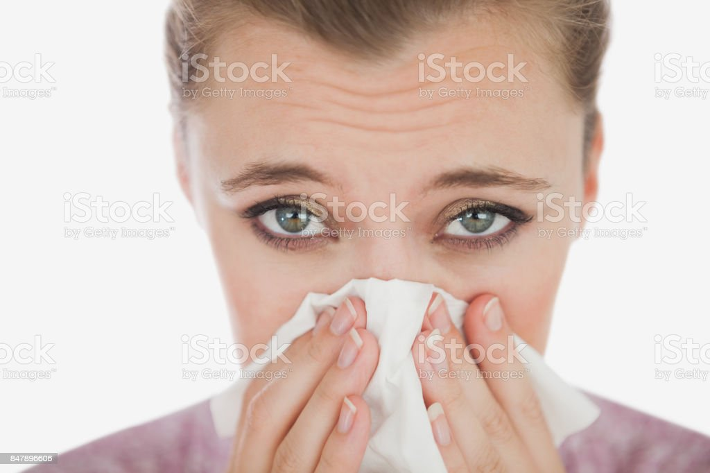 Portrait of woman suffering from cold stock photo
