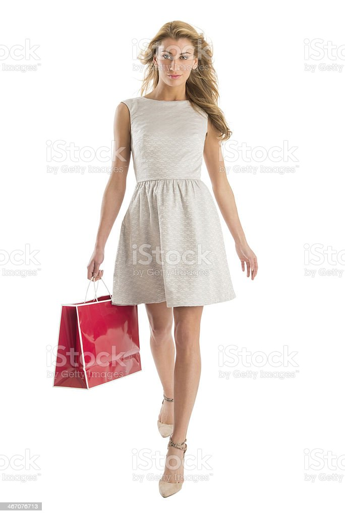 Portrait Of Woman Walking With Shopping Bag stock photo