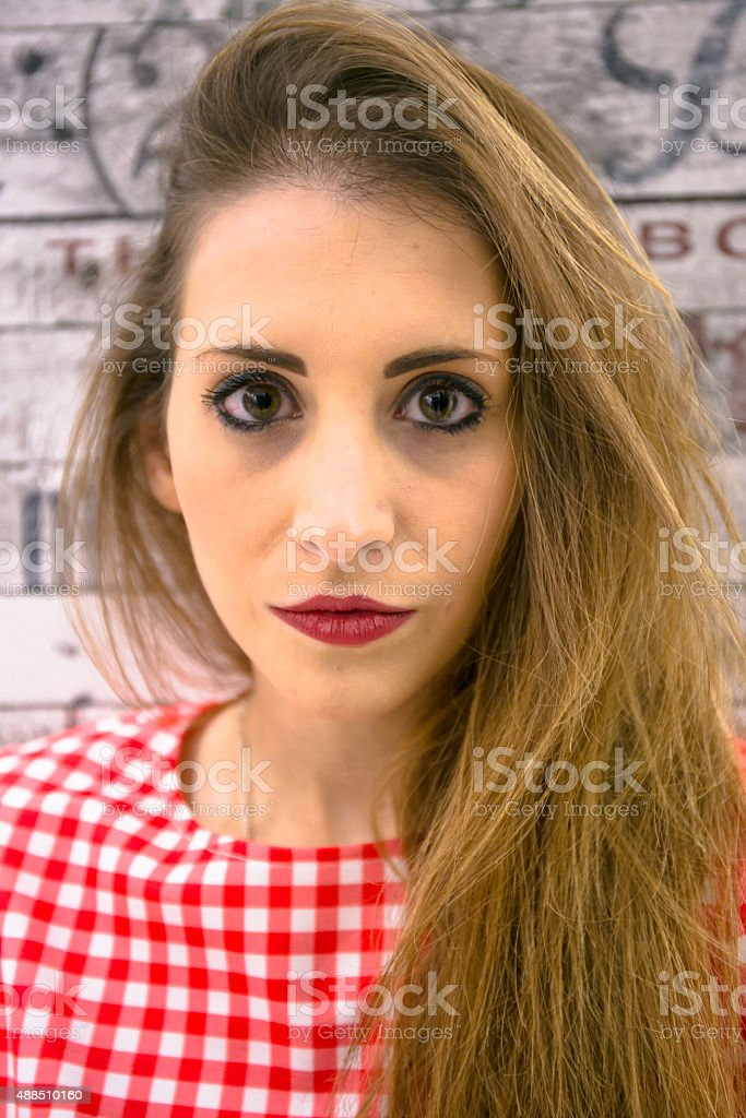 Portrait of Woman wearing a red and white checked shirt stock photo