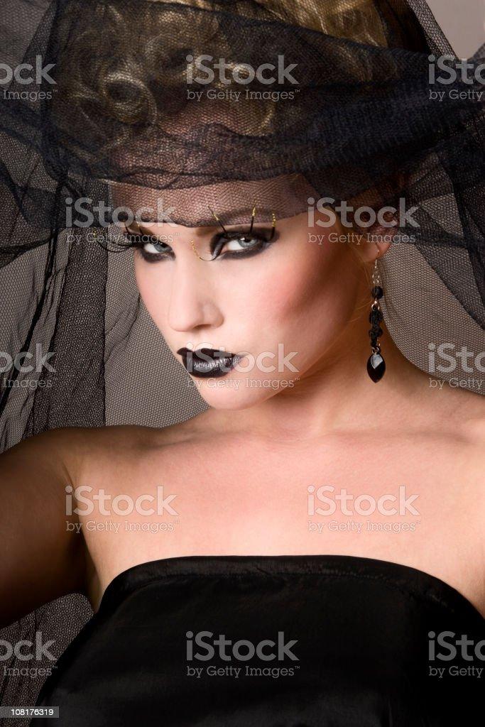 Portrait of Woman Wearing Black Netting royalty-free stock photo
