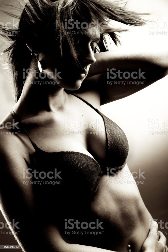 Portrait of Woman Wearing Bra, Black and White royalty-free stock photo