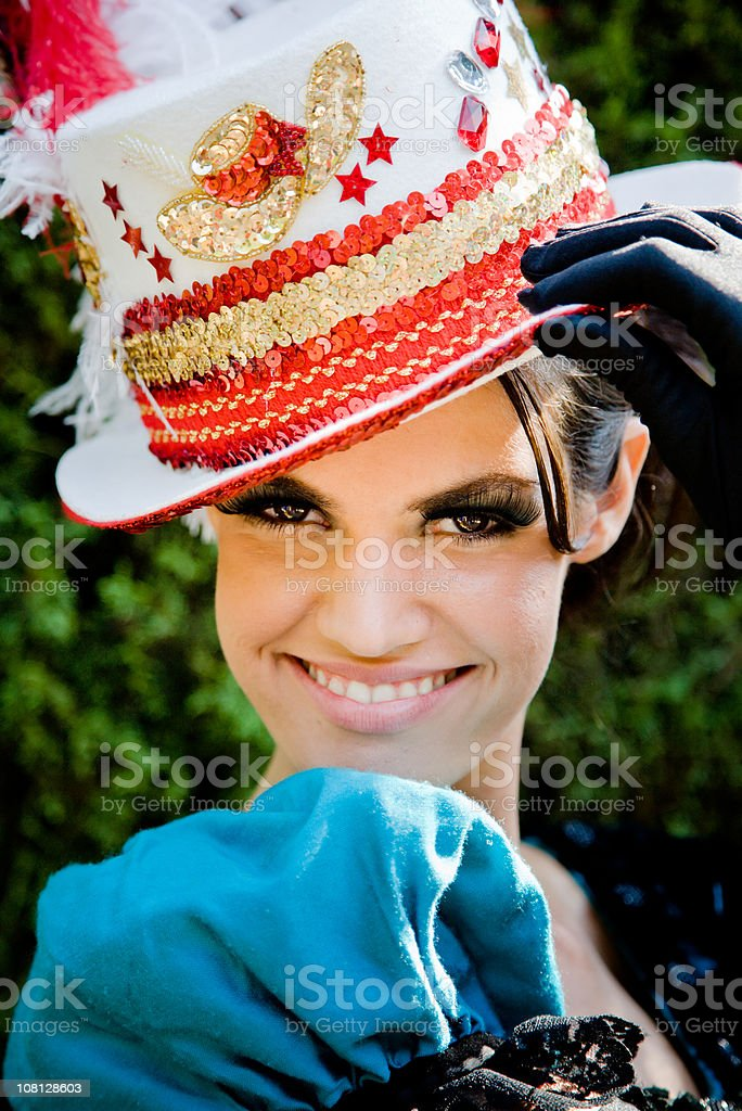 Portrait of Woman Wearing Cabaret Hat Outdoors stock photo