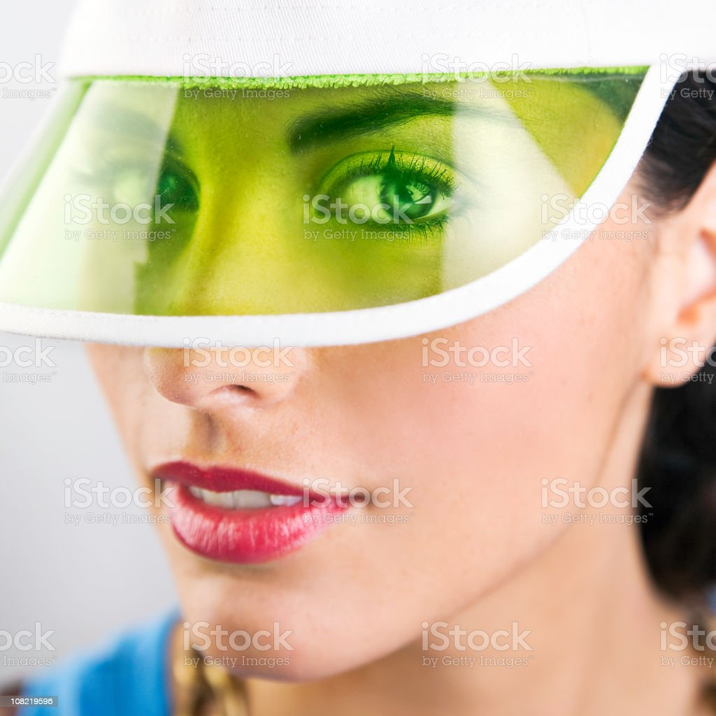 Portrait of Woman Wearing Hat with Green Plastic Brim royalty-free stock photo