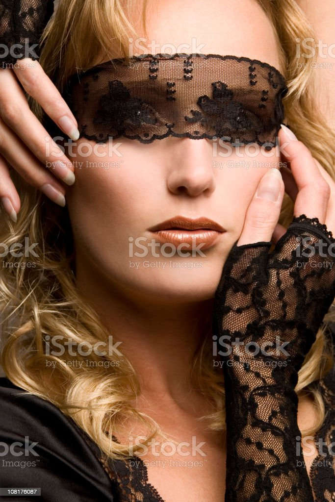 Portrait of Woman Wearing Lace Blindfold royalty-free stock photo