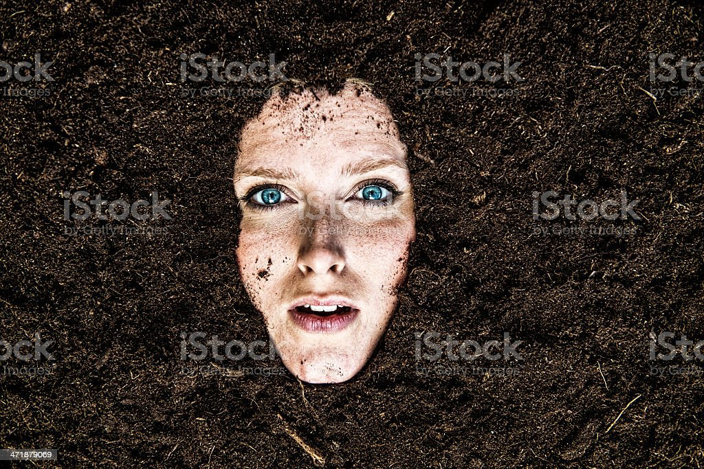 Portrait of woman who is buried in a garden stock photo