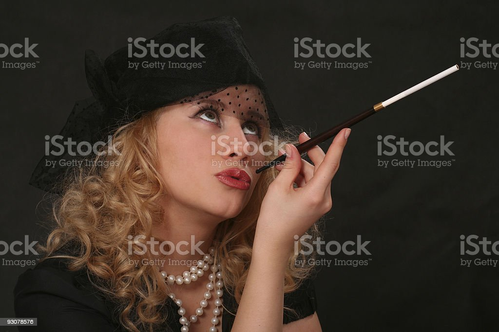 portrait of  woman with a cigarette holder. royalty-free stock photo