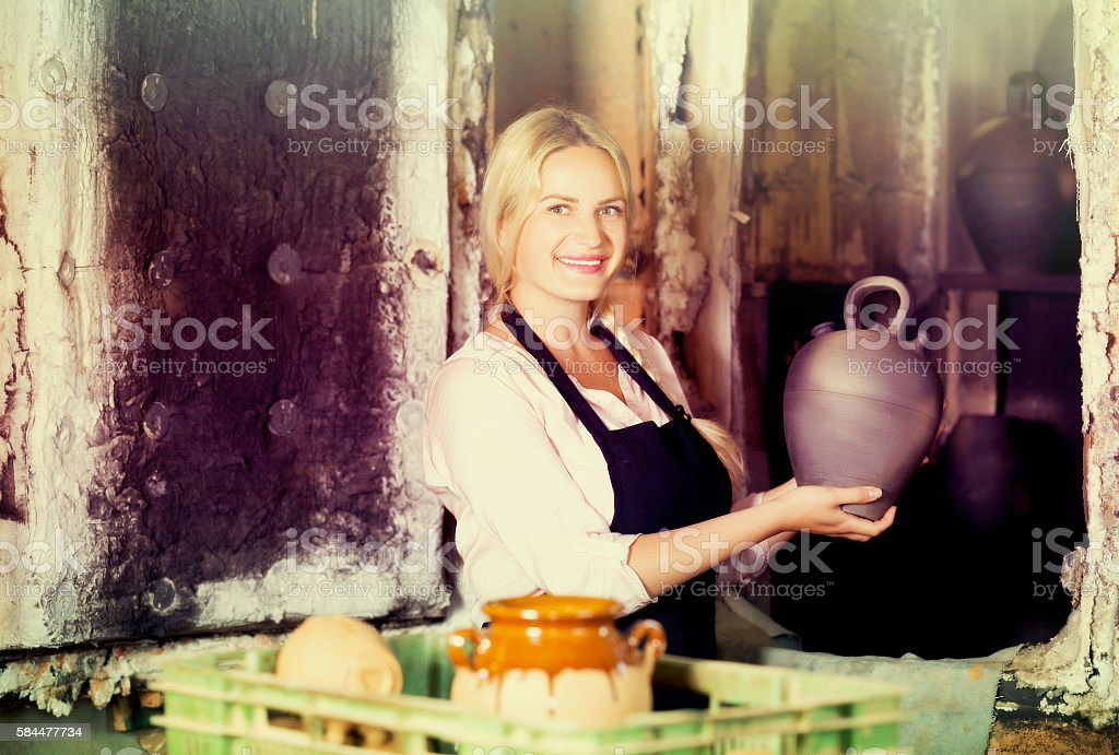 Portrait of  woman with black glaze pot stock photo
