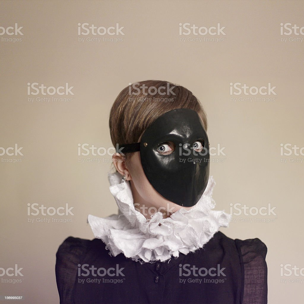Portrait of  woman with black mask stock photo