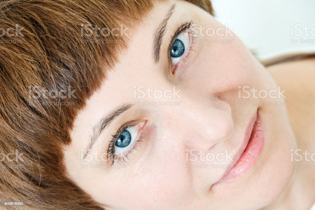 Portrait of woman with blue eyea stock photo