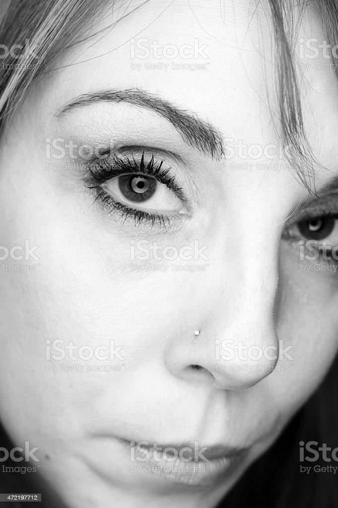 Portrait of Woman with Catchlights and Nose Stud stock photo